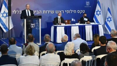 Israeli Prime Minister Naftali Bennett speaks at the changing-of-the guard ceremony, at the Prime Minister's Office in Jerusalem, for the outgoing and incoming head of the Shin Bet. To his right is incoming director Ronen Bar, seated next to outgoing head Nadav Argaman. Oct. 14, 2021. Credit: Haim Zach/GPO.