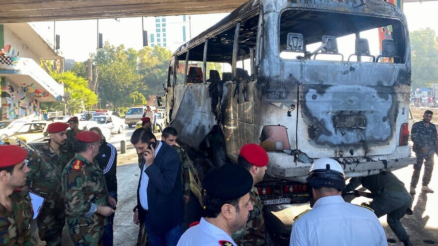 Syrian security forces inspect the site of the explosion on a bus in central Damascus, Oct. 20, 2021. Source: Twitter/Sky News.